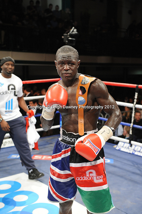 Eric Ochieng defeats Nick Quigley after his corner throw in the towel claiming The English Light Middleweight Title on the 28th January 2012 at York Hall, Bethnal Green, London. Matchroom Sport. © Leigh Dawney Photography 2012.