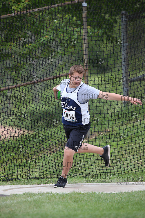 Colton McLean of Orillia District CVI - Orillia competes in the midget boys discus at the 2013 OFSAA Track and Field Championship in Oshawa Ontario, Thursday,  June 6, 2013.<br /> Mundo Sport Images / Sean Burges