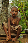 South Pacific Islander boy posing for the camera with a thumbs up