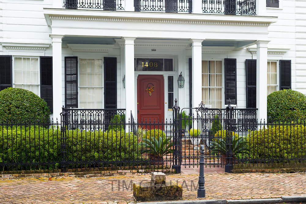 Traditional grand mansion house with columns and porch in the Garden District of New Orleans, Louisiana, USA