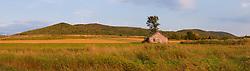 An old farm building in a field next to the Mars Hill wind farm in Mars Hill, Maine. The International Appalachian Trail traverses the ridge on Mars Hill.