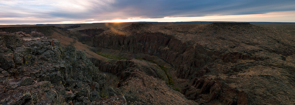 Sun bounces from the basalt cliff walls above Jacks Creek in the Owyhee Canyonlands, Idaho.