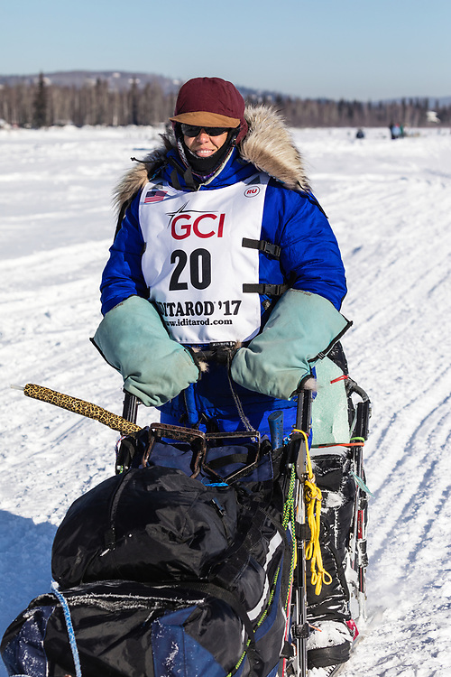 Musher Karin Hendrickson competing in the 45rd Iditarod Trail Sled Dog Race on the Chena River after leaving the restart in Fairbanks in Interior Alaska.  Afternoon. Winter.