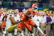 Clemson Tigers wide receiver Justyn Ross (8) catches the ball over the middle while Troy Pride Jr. (5) tries to take him down during the game of the NCAA Cotton Bowl semi-final playoff football game, Saturday, Dec. 29, 2018, in Arlington, Texas. Clemson defeated Notre Dame 30-3 to advance to the College Football Playoff national Championship. (Mario Terana/Image of Sport)