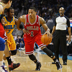 February 12, 2011; New Orleans, LA, USA; Chicago Bulls point guard Derrick Rose (1) drives past New Orleans Hornets point guard Chris Paul (3) during the first quarter at the New Orleans Arena.   Mandatory Credit: Derick E. Hingle