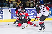 KELOWNA, CANADA - DECEMBER 8: Henrik Nyberg #21 of the Kelowna Rockets is checked by Raymond Grewal #29 of the Prince George Cougars at the Kelowna Rockets on December 8, 2012 at Prospera Place in Kelowna, British Columbia, Canada (Photo by Marissa Baecker/Shoot the Breeze) *** Local Caption ***
