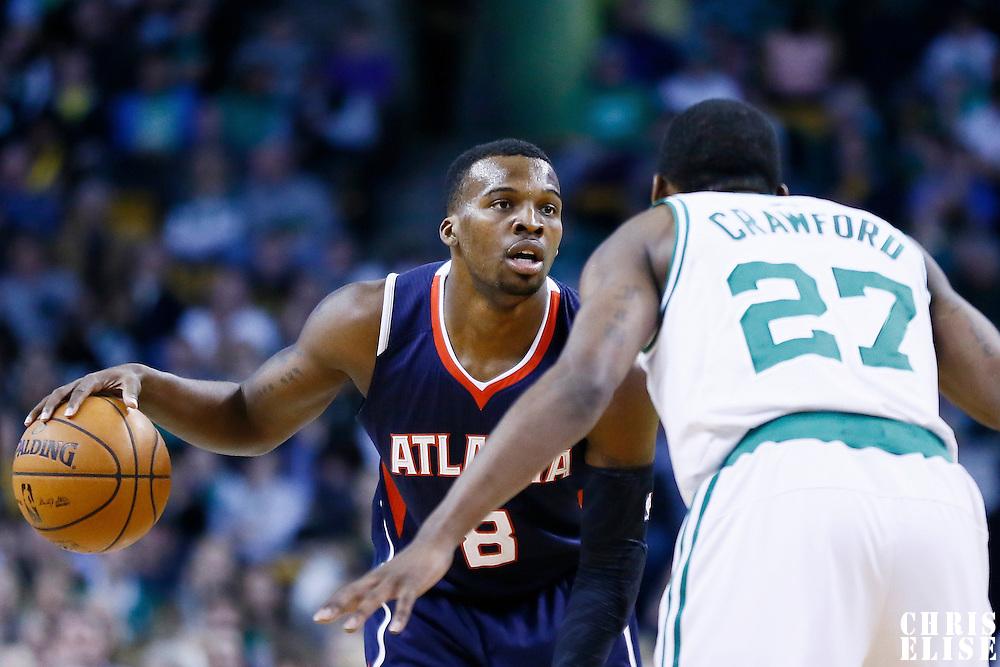 29 March 2013: Atlanta Hawks point guard Shelvin Mack (8) looks to pass the ball during the Boston Celtics 118-107 victory over the Atlanta Hawks at the TD Garden, Boston, Massachusetts, USA.