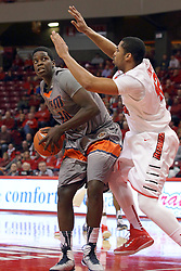 17 December 2014: Arkeem Joseph tries to fake off Will Ransom during an NCAA Men's Basketball game between the Skyhawks of University of Tennessee - Martin and the Redbirds of Illinois State at Redbird Arena in Normal Illinois