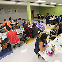 A group of new teachers to the Tupelo Public School District go through Wednesday's orientation at rankin Elementary School.