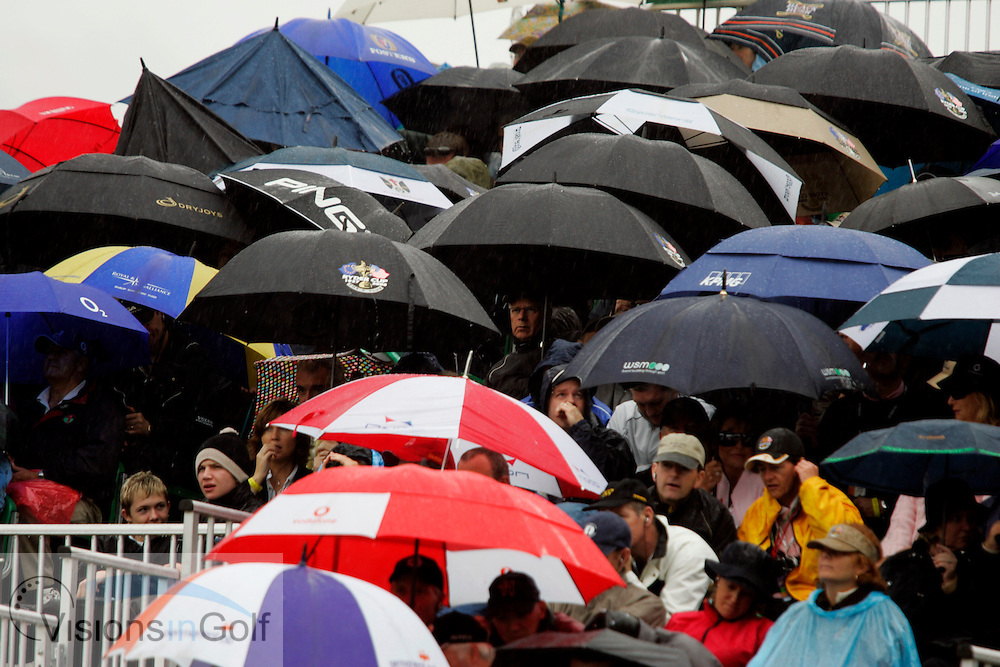Spectators shelter under umbrellas from the rain and wet in the stands on the second morning at the 36th Ryder Cup Matches 2006, K Club, Ireland, 060922<br /> Picture Credit: Mark Newcombe / visionsingolf.com