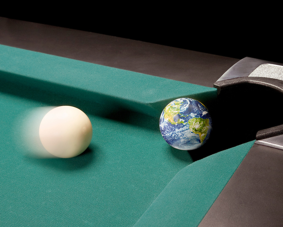 A cue ball is about to knock the Earth into a corner pocket of a pool table.