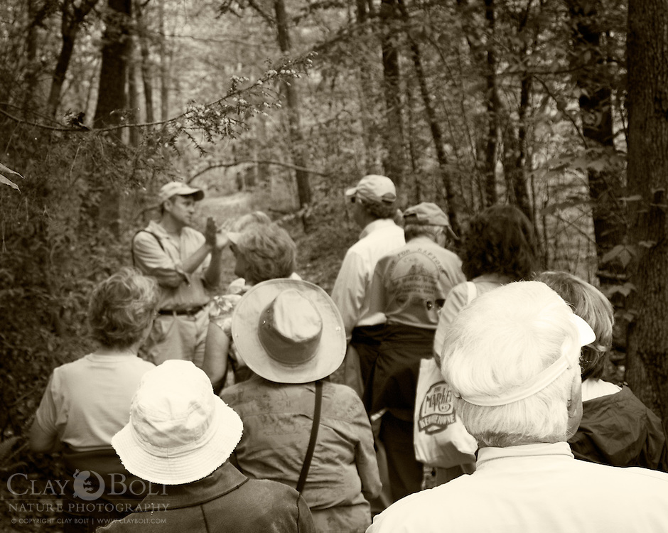 Botanist and TV personality Dr. Patrick McMillan discusses plants with group during The Nature Conservancy's Nine Times Preserve Dedication Ceremony. Dr. McMillan was one of the first to do a botanical survey of the site and discovered many rare and important species during the process.