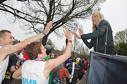 © Licensed to London News Pictures. 06/04/2014. Brighton, UK. Paula Radcliffe high-five's the runners at the start . The weather is cool for runners of this year's Brighton Marathon.. Photo credit : Graham M. Lawrence/LNP