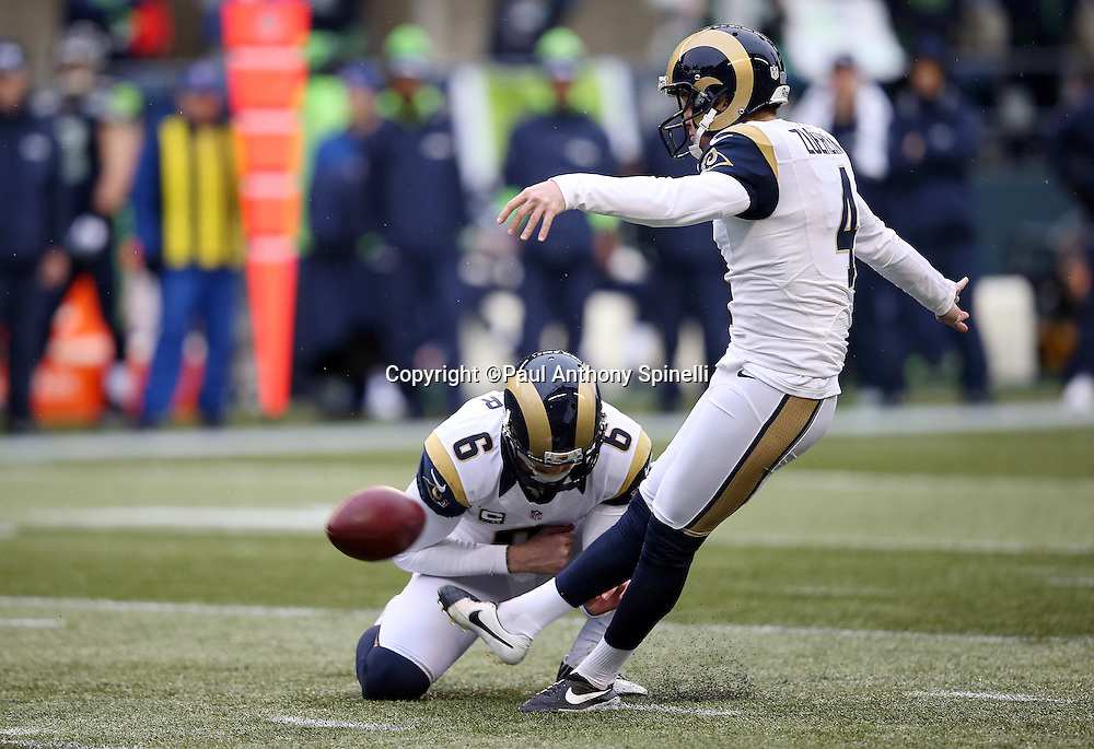 St. Louis Rams punter Johnny Hekker (6) holds while St. Louis Rams kicker Greg Zuerlein (4) kicks a 42 yard field goal good for a 3-0 first quarter Rams lead during the 2015 NFL week 16 regular season football game against the Seattle Seahawks on Sunday, Dec. 27, 2015 in Seattle. The Rams won the game 23-17. (©Paul Anthony Spinelli)