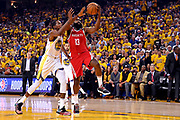 May 26, 2018; Oakland, CA, USA; Houston Rockets guard James Harden (13) shoots the ball against Golden State Warriors forward Kevin Durant (35) during the first quarter in game six of the Western conference finals of the 2018 NBA Playoffs at Oracle Arena.