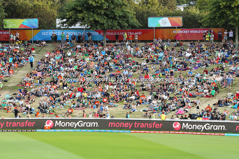 Cricket fans watch from the embankment during the ICC Cricket World Cup match - South Africa v Zimbabwe at Seddon Park, Hamilton, New Zealand on Sunday 15 February 2015.  Photo:  Bruce Lim / www.photosport.co.nz