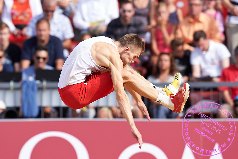 Tomasz Jaszczuk from Poland competes in men's long jump final during the Sixth Day of the European Athletics Championships Zurich 2014 at Letzigrund Stadium in Zurich, Switzerland.<br /> <br /> Switzerland, Zurich, August 17, 2014<br /> <br /> Picture also available in RAW (NEF) or TIFF format on special request.<br /> <br /> For editorial use only. Any commercial or promotional use requires permission.<br /> <br /> Photo by &copy; Adam Nurkiewicz / Mediasport