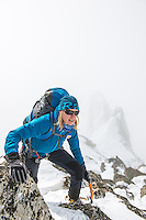 Squash Falconer, a female British adventurer as seen druing traverse of a rock feature on Aiguilles Marbrées.