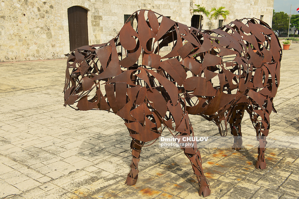 SANTO DOMINGO, DOMINICAN REPUBLIC - NOVEMBER 08, 2012: Exterior of the Iron Bull artwork at Santo Domingo Colonial Zone in Santo Domingo, Dominican Republic. Artwork produced by the famous dominican Jose Ignacio Morales's studio El Artistico.