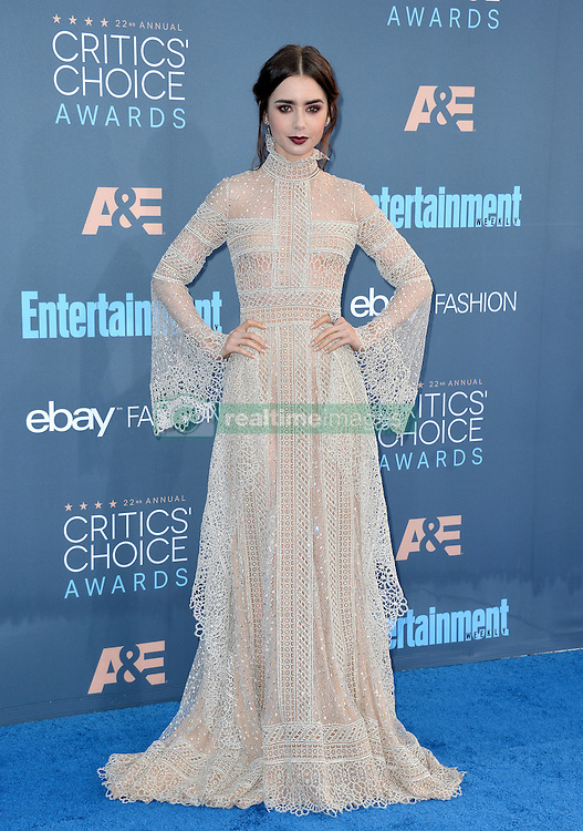 Lily Collins attends the 22nd Annual Critics' Choice Awards at Barker Hangar on December 11, 2016 in Santa Monica, Los Angeles, CA, USA. Photo By Lionel Hahn/ABACAPRESS.COM