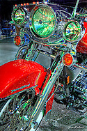 Tim took home top honors at Quaker Steak's weekly bike contest mc'ed by Radical Randy. This Harley is a Firefighter Special Edition. Lots of chrome and in perfect condition. Q. Why is there green reflecting off the headlights and chrome? A. Green neon from the Quaker Steak building.