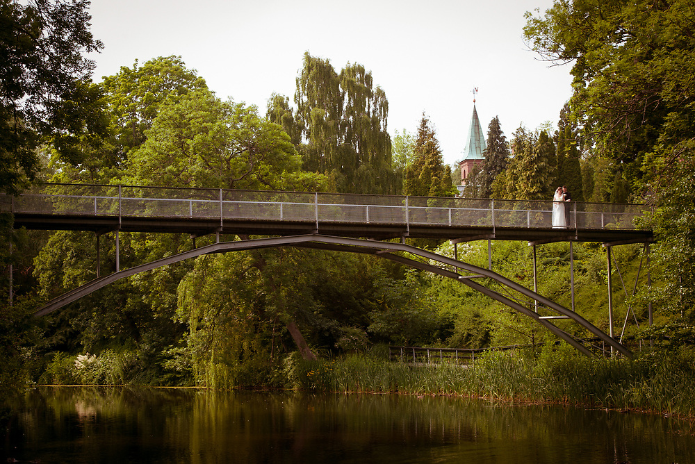 A loving couple caught on Fredensborg bridge in Zealand Copenhagen from a distance.