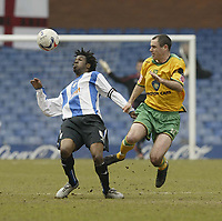Photo: Aidan Ellis.<br /> Sheffield Wednesday v Norwich City. Coca Cola Championship. 15/04/2006.<br /> Sheffield's Yoann Folly and Norwich's Andy Hughes