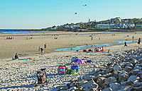 Beach, Ogunquit, Maine, USA, paddling pool, bathers, sunbathers, kites, rocks, blue sky, sea, Atlantic Ocean, 201110105089.<br /> <br /> Copyright Image from Victor Patterson, 54 Dorchester Park, Belfast, UK, BT9 6RJ<br /> <br /> t1: +44 28 9066 1296 (from Rep of Ireland 048 9066 1296)<br /> t2: +44 28 9002 2446 (from Rep of Ireland 048 9002 2446)<br /> m: +44 7802 353836<br /> <br /> victorpatterson@me.com<br /> www.victorpatterson.com<br /> <br /> Please see my Terms and Conditions of Use at victorpatterson.com . It is IMPORTANT that you familiarise yourself with them.<br /> <br /> Images used on the Internet incur an additional cost and must be visibly watermarked i.e. ©Victor Patterson within the body of the image and copyright metadata must not be deleted. Images used on the Internet have a size restriction of 4kbs and are chargeable at rates available at victorpatterson.com.<br /> <br /> This image is only available for the use of the download recipient i.e. television station, newspaper, magazine, book publisher, etc, and must not be passed on to any third party. It is also downloaded on condition that each and every usage is notified within 7 days to victorpatterson@me.com<br /> <br /> The right of Victor Patterson to be identified as the author is asserted in accordance with The Copyright Designs And Patents Act (1988). All moral rights are asserted.