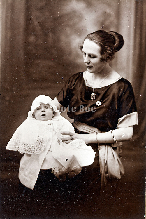studio portrait of mother with baby