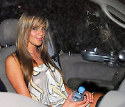 24.FEBRUARY.2007. LONDON<br /> <br /> A WORSE FOR WEAR DANIELLE LLOYD LEAVING EMBASSY CLUB AT 3.30AM BEING HELD UP BY BOUNCERS AS SHE WALKED TO HER CAR AND SAT DRINKING A BOTTLE OF WATER.<br /> <br /> BYLINE: EDBIMAGEARCHIVE.CO.UK<br /> <br /> *THIS IMAGE IS STRICTLY FOR UK NEWSPAPERS AND MAGAZINES ONLY*<br /> *FOR WORLD WIDE SALES AND WEB USE PLEASE CONTACT EDBIMAGEARCHIVE - 0208 954 5968*