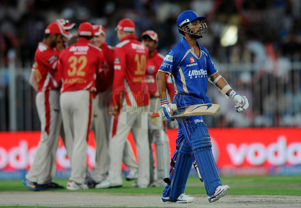 Ajinkya Rahane of the Rajatshan Royals walks back after getting out during match 7 of the Pepsi Indian Premier League 2014 between the Rajasthan Royals and The Kings XI Punjab held at the Sharjah Cricket Stadium, Sharjah, United Arab Emirates on the 20th April 2014<br /> <br /> Photo by Pal Pillai / IPL / SPORTZPICS