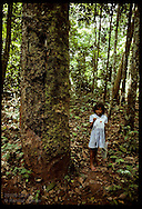 Rubber tapper's daughter studies plant on hour walk thru jungle to school;Seringal Cachoeira, AC Brazil