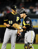 Sep. 20 2011; Phoenix, AZ, USA; Pittsburgh Pirates pitcher Charlie Morton (50) talks with catcher Ryan Doumit (41) on the field while playing against the Arizona Diamondbacks at Chase Field.  Mandatory Credit: Jennifer Stewart-US PRESSWIRE..