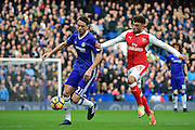 Chelsea midfielder Nemanja Matic (21) in action against Arsenal midfielder Alex Oxlade-Chamberlain (15) during the Premier League match between Chelsea and Arsenal at Stamford Bridge, London, England on 4 February 2017. Photo by Jon Bromley.