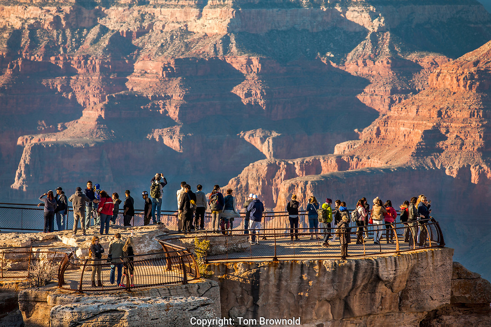 tourists over looking grand canyon on Mather point.