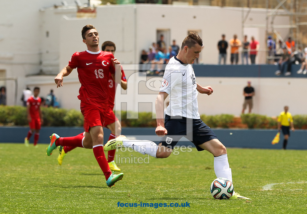Callum Cooke (right) of England shapes up to shoot during the 2014 UEFA European Under-17 match at Gozo Stadium, Xewkija<br /> Picture by Tom Smith/Focus Images Ltd 07545141164<br /> 12/05/2014