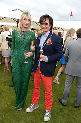 ANDY WONG and OLIVIA BUCKINGHAM at the 2013 Cartier Queens Cup Polo at Guards Polo Club, Berkshire on 16th June 2013.
