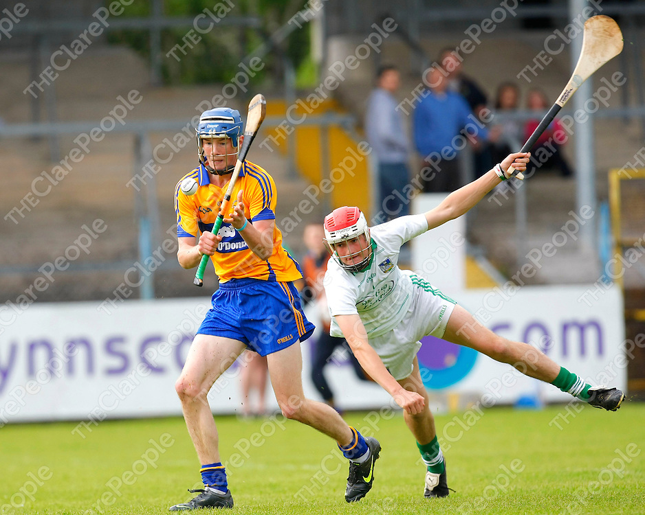 29/06/12<br /> Clare's Bobby Duggan gets past Darragh Stapleton of Limerick to score the opening goal in the Electric Ireland Munster Minor Hurling Semi Final at Cusack Park, Ennis on Friday Evening.<br /> Pics: Don Moloney / Press 22