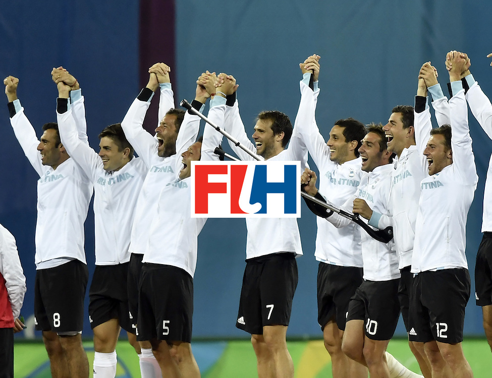 Argentina's players celebrate on the podium during the men's field hockey medals ceremony of the Rio 2016 Olympics Games at the Olympic Hockey Centre in Rio de Janeiro on August 18, 2016. / AFP / PHILIPPE LOPEZ        (Photo credit should read PHILIPPE LOPEZ/AFP/Getty Images)