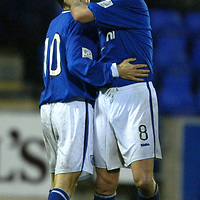 St Johnstone v Queen of the South....20.12.03<br />Ryan Stevenson celebrates St Johnstone getting the lead with Simon Donnelly<br /><br />Picture by Graeme Hart.<br />Copyright Perthshire Picture Agency<br />Tel: 01738 623350  Mobile: 07990 594431