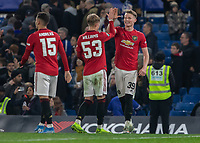Football - 2019 / 2020 EFL Carabao (League) Cup - Fourth Round: Chelsea vs. Manchester United<br /> <br /> Scott McTominay (Manchester United) high fives at the end of the game with Brandon Williams (Manchester United) at Stamford Bridge <br /> <br /> COLORSPORT/DANIEL BEARHAM