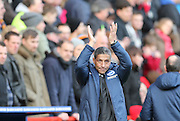Chris Hughton applauds the Albion fans during the Sky Bet Championship match between Charlton Athletic and Brighton and Hove Albion at The Valley, London, England on 10 January 2015.
