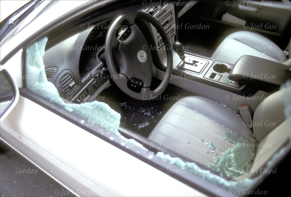Parked car on city street - Crime - car vandalism - car window broken, radio stolen - NYC