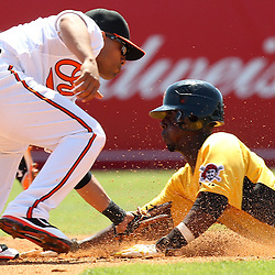 March 14, 2011; Sarasota, FL, USA; Baltimore Orioles shortstop Cesar Izturis (3) tags out Pittsburgh Pirates shortstop Pedro Ciriaco (3) on an attempted steal during a spring training exhibition game at Ed Smith Stadium.   Mandatory Credit: Derick E. Hingle