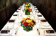 SHOT 7/25/13 12:51:32 PM - A detail of place settings and flower vases full of colorful flower arrangements in the Mooney Private Dining Room at Shanahan's Steakhouse in Denver, Co. (Photo by Marc Piscotty / © 2013)