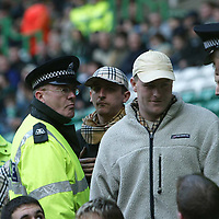 Celtic v St Johnstone...23.02.03<br />St Johnstone fans being removed from  Parkhead<br /><br />Picture by Graeme Hart.<br />Copyright Perthshire Picture Agency<br />Tel: 01738 623350  Mobile: 07990 594431