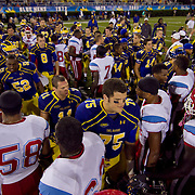 Delaware and Delaware State players meet at midfield after a Week 2 NCAA football game Saturday Sept. 08, 2012 in Newark Delaware.