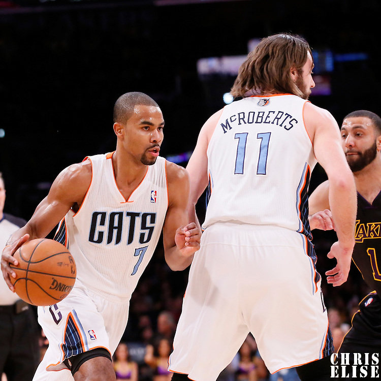 31 January 2014: Charlotte Bobcats point guard Ramon Sessions (7) drives past Los Angeles Lakers point guard Kendall Marshall (12) on a screen set by Charlotte Bobcats power forward Josh McRoberts (11) during the Charlotte Bobcats 110-100 victory over the Los Angeles Lakers at the Staples Center, Los Angeles, California, USA.