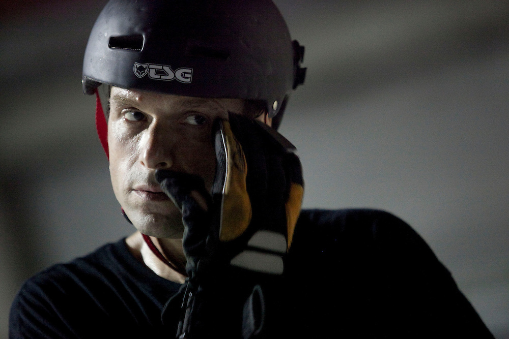 Mike Lippy, 44, wipes sweat from his face at a garage in Fells Point in Baltimore on Wednesday, June 16, 2010.