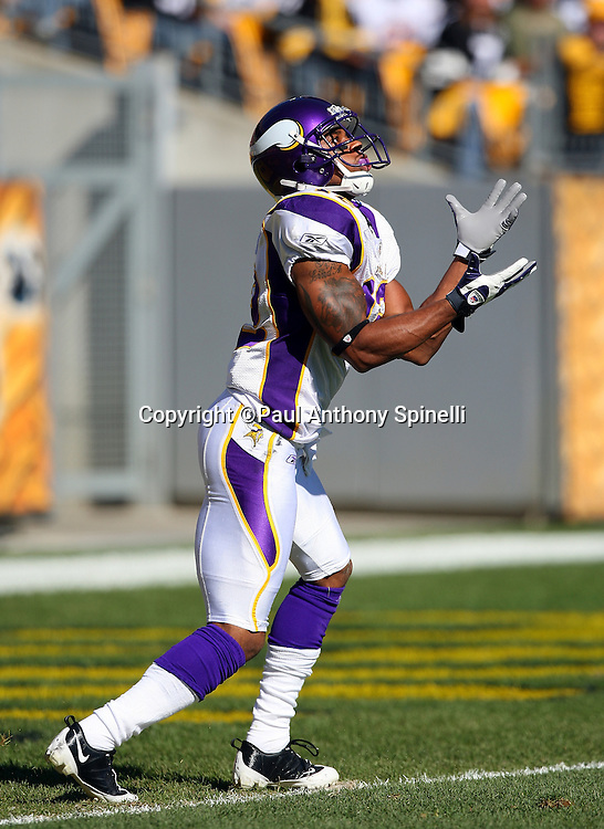 Minnesota Vikings kick returner Percy Harvin (12) looks up to catch a kickoff during the NFL football game against the Pittsburgh Steelers, October 25, 2009 in Pittsburgh, Pennsylvania. The Steelers won the game 27-17. (©Paul Anthony Spinelli)